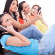Teenagers using cell phones — Stock Photo
