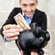 Businesswoman with piggy bank - Lizenzfreies Foto