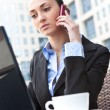 Young business woman calling by telephone — Stock Photo
