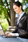 Businesswoman working outdoor — Stock Photo