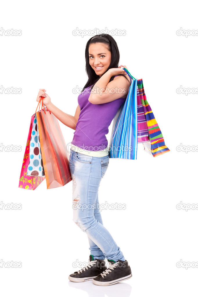 Young girl holding shopping bags, isolated on white background — Stock Photo #5832502