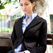 Business woman working in park — Stock Photo