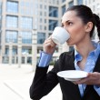 Businesswoman drinking coffee — Stock Photo #5878887