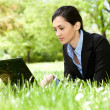 Stock Photo: Girl working on laptop outdoor
