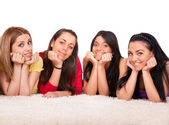 Four beautiful girls on the floor — Stock Photo