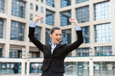 Businesswoman with raising arms — Stock Photo