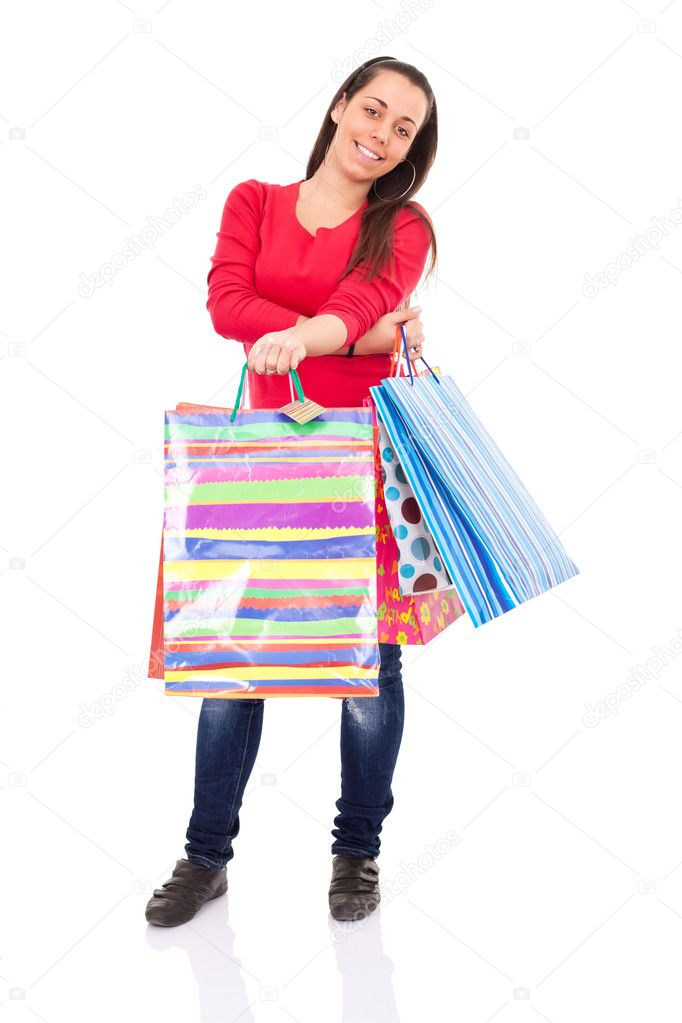 Young shopping girl holding color shopping bags, isolated on white background — Stock Photo #5878644