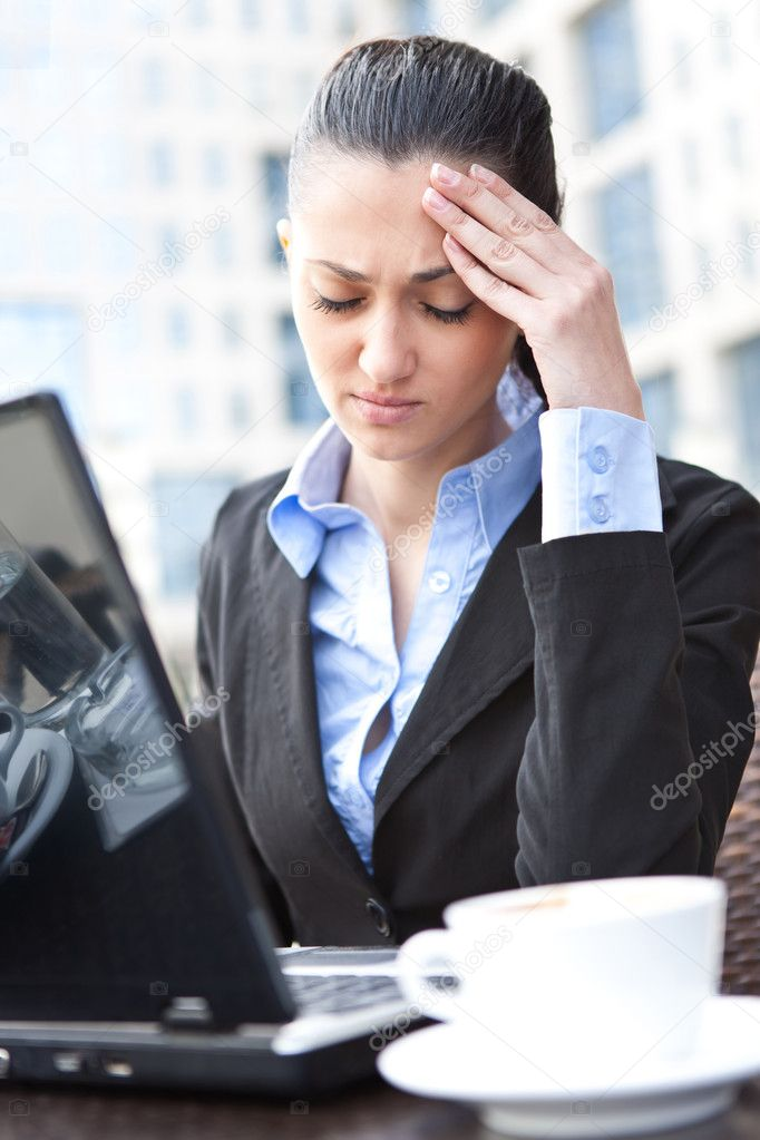 Stressed businesswoman with a problem having headache — Stock Photo #5878894