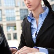 Business woman working in internet cafe — Stock Photo
