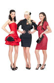 Three sexy girls posing in fashion dresses — Stok fotoğraf