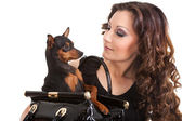 Beautiful woman with dog in purse — Stock Photo
