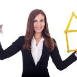 Businesswoman giving keys — Stock Photo