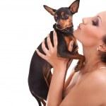 Girl kissing her dog — Stock Photo