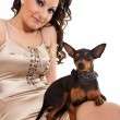 Stock Photo: Fashion womwith dog shoulder