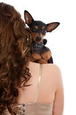 Dog on woman's shoulder — Stock Photo