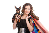 Shopping posh girl with miniature pinscher — Stock Photo