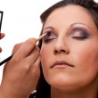 Stock Photo: Makeup artist applying eyeshadow
