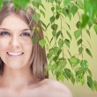 Royalty-Free Stock Photo: Smiling woman with leaves