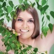 Beauty girl in the greenery — Stock Photo