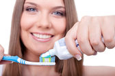 Beauty young woman brushing her teeth — Stock Photo