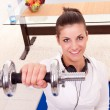 Young woman holding weights — Stock Photo