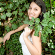 Girl near green tree — Stock Photo