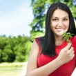 Smiling young woman with flower — Stock Photo