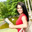 Girl with book outdoor — Stock Photo