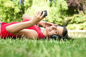 Young woman listening to music — Stock Photo