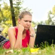 Angry woman  looking in laptop - Stockfoto