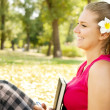 Stock Photo: Smiling student girl in park