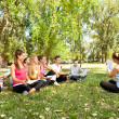 Teacher with students in park — Stock Photo