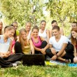 Students with laptop in park — Stock Photo