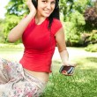 Young lady listening music — Stock Photo
