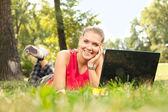 Girl and laptop in park — Stock Photo