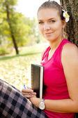Cute student girl outdoor — Stock Photo