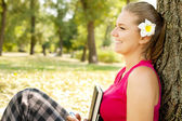 Smiling student girl in park — Stock Photo