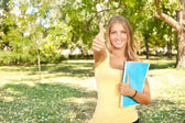 Student with thumb up — Stock Photo