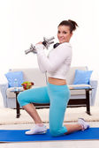 Woman exercising with weights — Stockfoto