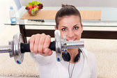 Girl holding weights — Stock Photo