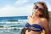 Woman in bikinis sunbathing — Stock Photo