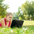 Stock Photo: Women using laptop in park