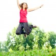 Girl jumping in the park — Stock Photo #6627824