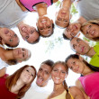 Happy group of friends hugging and smiling - Stock Photo