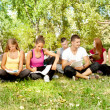 Group of young students  in park — Stock Photo