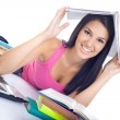 Student girl with book on head — Stock Photo