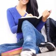 Student girl sitting in school hallway — Stock Photo