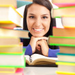 Royalty-Free Stock Photo: Student girl between stack of books