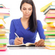 Student girl writing — Stockfoto #6628831