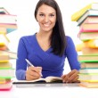 Smiling student wit lot of books — Stok fotoğraf